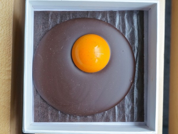 Dark chocolate fried egg with saffron ganach yolk